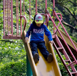 Child going down on a slide