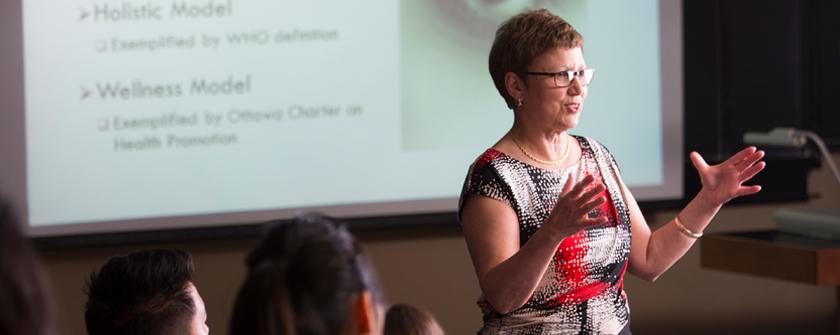 Health Studies Professor talking with students
